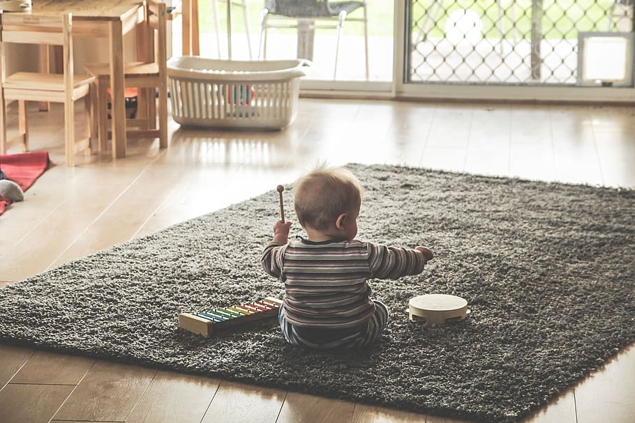little kid playing